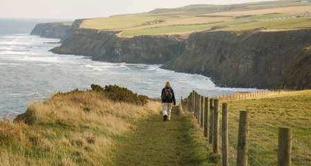 exhilarating: Walker on the coastal path, the Cleveland way in North Yorkshire, England, UK.