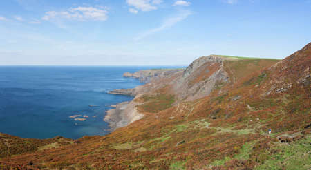 walk path: Panoramic view of cliffs and coastline from the South West Coast Path near Crackington Haven in North Cornwall, England.