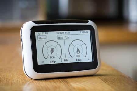 depth gauge: Smart Meter on a Kitchen Worktop Displaying Current Electricity and Gas Usage