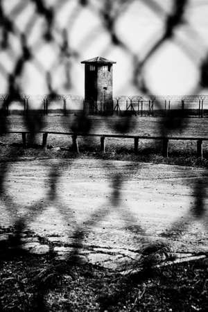 robben island: A prison watchtower viewed through wire fencing on Robben Island in Cape Town, South Africa