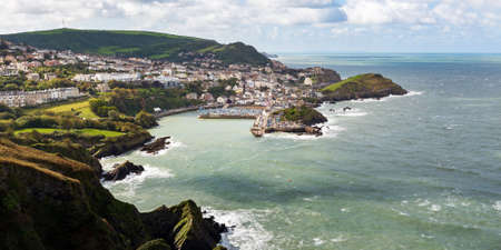 Seaside town of Ilfracombe in North Devon, England. Panoramic view from high cliffs on the South West coast path. Stock Photo