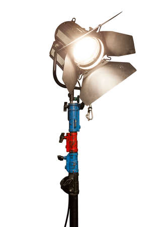 Close Up of an illuminated studio light on a stand. Isolated on a white background. Banco de Imagens