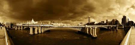 Panoramic of River Thames, London with storm clouds brewing... Stock Photo
