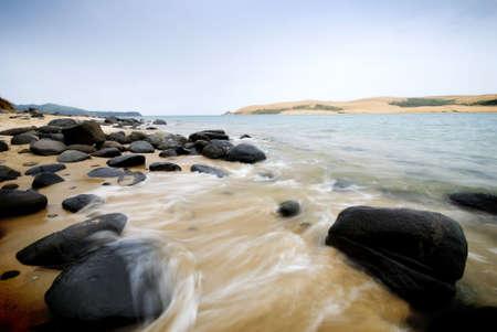 crashing: Wave crashing in on beautiful coastline Stock Photo