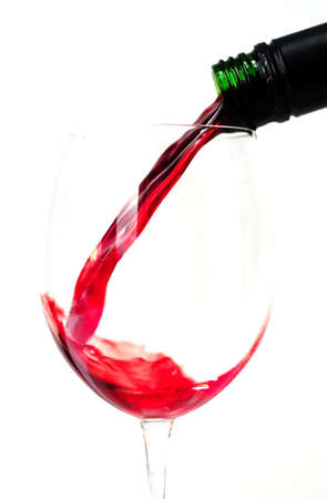 Red wine being poured from a wine bottle Stock Photo - 2487000