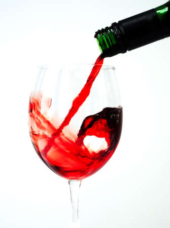 Red wine being poured from a wine bottle Stock Photo - 2487008