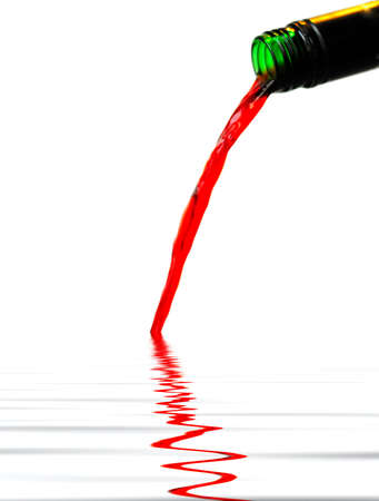 Red wine being poured from a wine bottle Stock Photo - 2487004