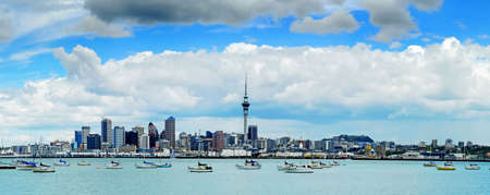 The beautiful Auckland skyline with white fluffy clouds... Stock Photo