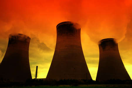 Global warming - Smoke pours from a powr plant at sunset
