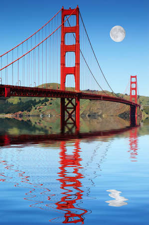 san fran: Golden Gate bridge San Francisco reflected in the beautiful still harbor with amazing daytime moon Stock Photo