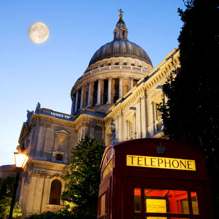 St. Pauls Cathedral with red phone box in foreground photo