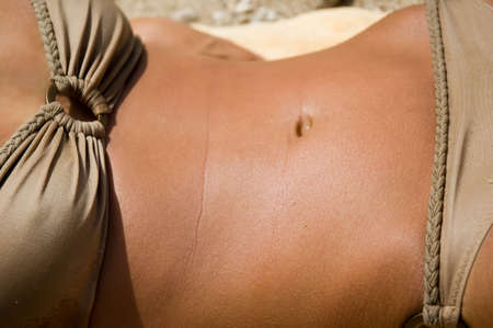Toned torso of a tanned female Stock Photo - 2487113