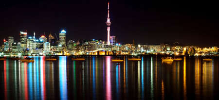 Beautiful Auckland Skyline with city lights reflected in the harbour