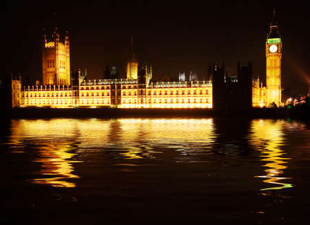 Westminster - houses of parliament reflected in the Thames at night photo