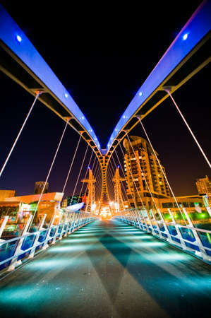 dynamic growth: Dynamic architectural designed modern corporate buildings at night time with lights Stock Photo