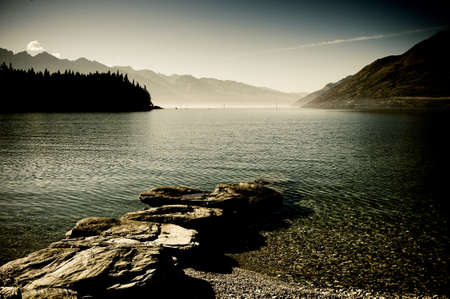 Panoramic landscape view of mountain lake and  blue sky.