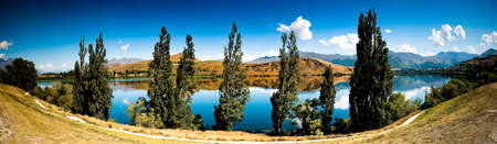 Panoramic landscape view of mountain lake and clear blue sky. Stock Photo - 7336826