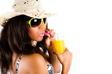 puckered lips: Beautiful young brunette woman in cowboy hat and sunglasses enjoying a cocktail with puckered lips - isolated on whit Stock Photo