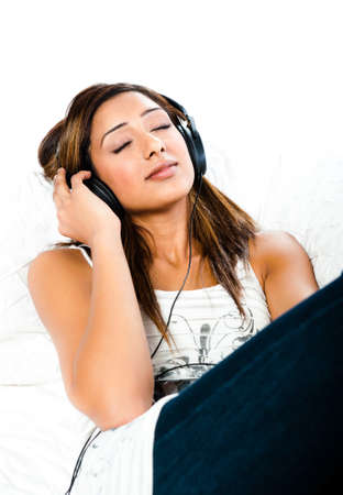 Beautiful indian teenage girl, listening to music with her eyes closed photo