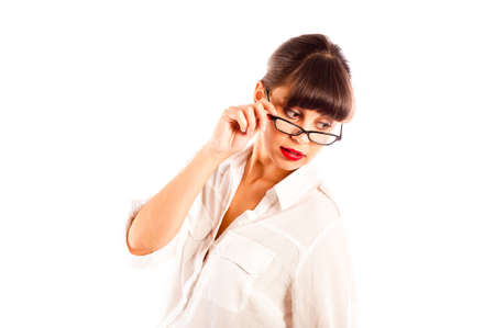 tilting: Beautiful young business woman in white, tilting glasses and red lips looking down