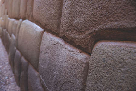 Famous ancient stone wall in Cusco, Peru dating back to the Inca Empire