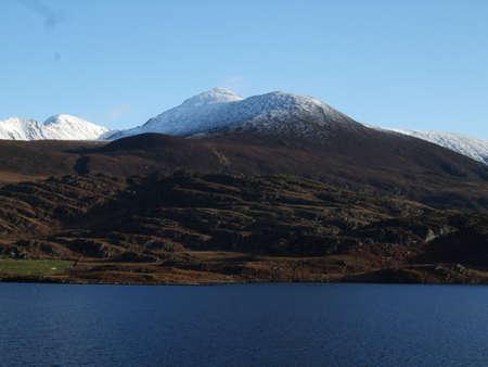 hillwalking: Lough Acoose lake under Carrauntoohil, Irelands highest mountain.