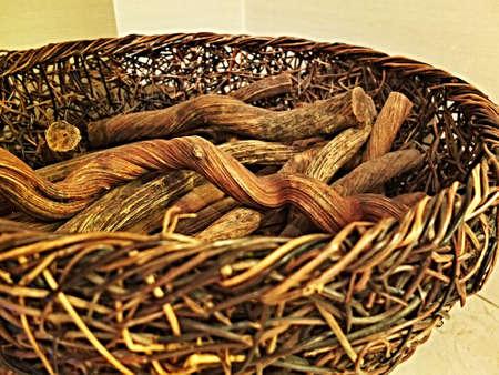 log basket: Wicker basket filled with decoration wood