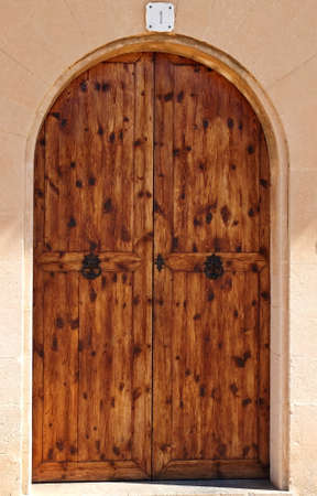 admittance: Oval wooden doors with ancient iron knocker and locker