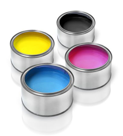 Tin cans with cmyk color paints cyan magenta yellow black photo