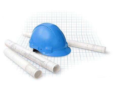Construction drawing blueprints and hard hat isolated on grid photo