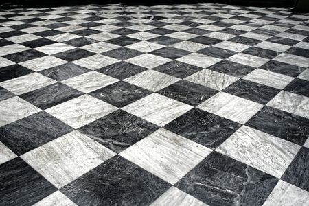 Black and white checquered marble floor pattern photo