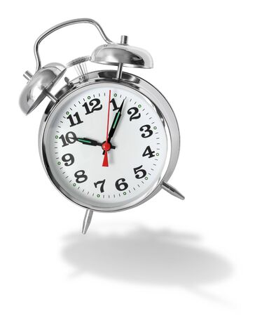 Metal alarm clock bouncing and ringing on white background Stock Photo - 7693661