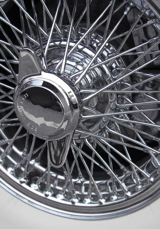 spoke: Shiny chromed spoke wheel of a classic sports car