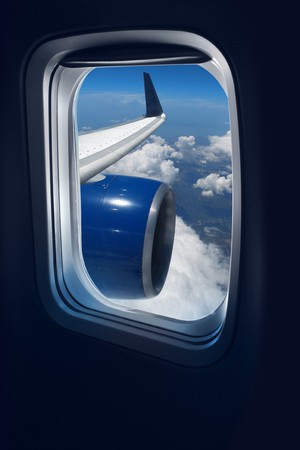 airplane window: View from a jet plane window high on the blue skies