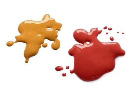 ketchup: Yellow mustard and dark red ketchup splatter on white background Stock Photo
