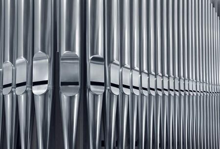 pipe organ: Close-up of modern steel organ pipe set horizontal Stock Photo