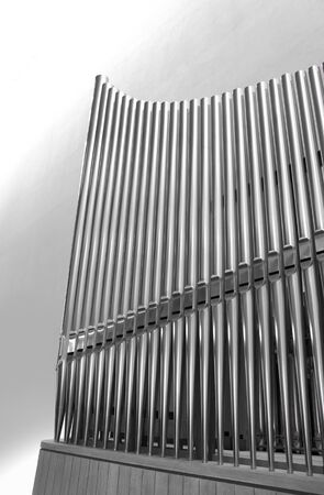 pipe organ: Set of modern steel organ pipes on light background Stock Photo