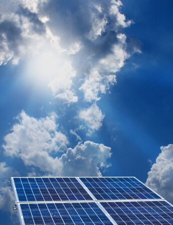 Group of four solar panels on sunny blue sky background photo