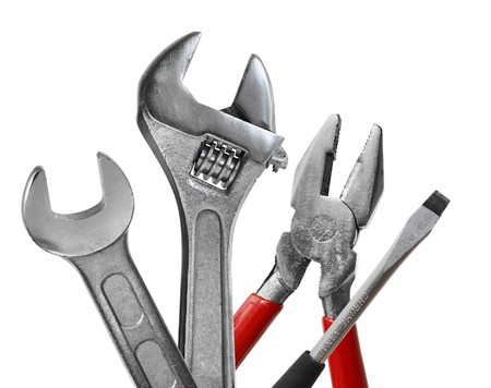 Tool set of wrench, adjustable spanner, pliers and screwdriver isolated on white background Stock Photo - 7944574
