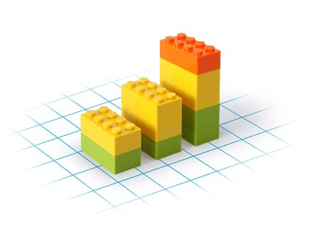 Business graph blocks on grid showing growth, white background photo