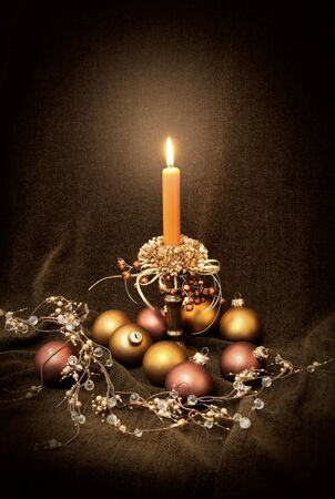 glowing ball: Romantic Christmas arrangement with old brass candlestick and glass balls