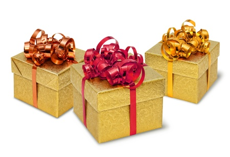 Three golden present gift boxes with silky bows and ribbons Stock Photo - 8331444