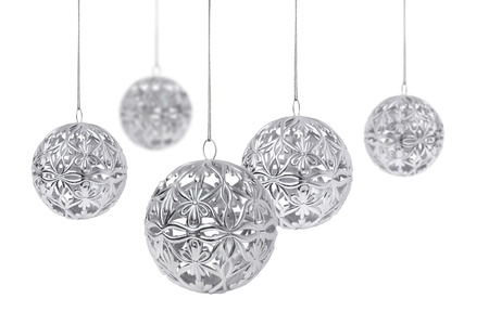 Shiny silver Christmas balls hanging, isolated on white background Stock Photo - 8331443