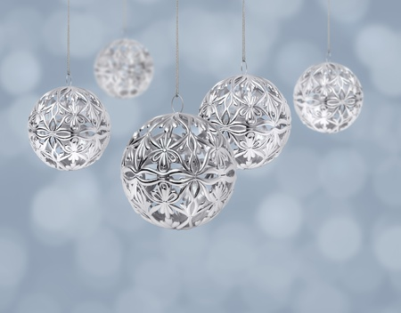 Shiny silver Christmas balls hanging on light blue background Stock Photo - 8331447