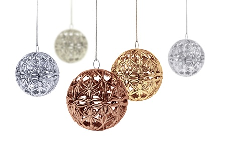 traditions: Gold copper silver Christmas balls hanging on white background