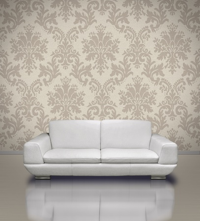 Modern white leather sofa in light damask pattern stucco wall room photo