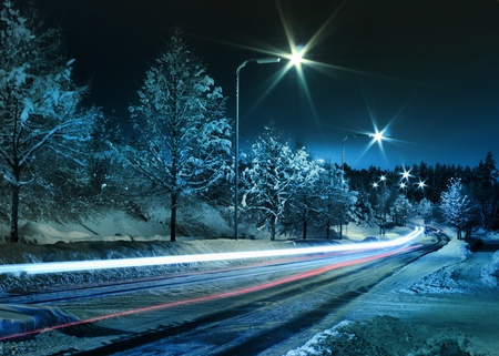 winter road: Small town street traffic on dark cold winter evening