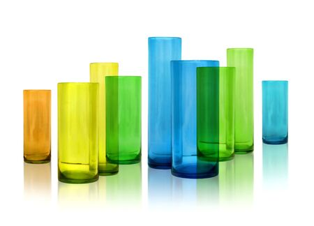 Modern color glass vases row on white reflective background Stock Photo - 8722243