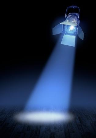 blue spotlight: Professional stage spotlight lamp beam on floor, dark background Stock Photo