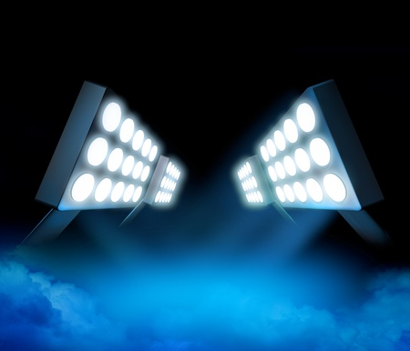 beam of light: Stadium style lights illuminating blue surface premiere with color smoke Stock Photo